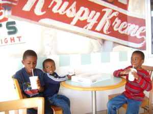 My boys eating donuts in Krispy Kreme